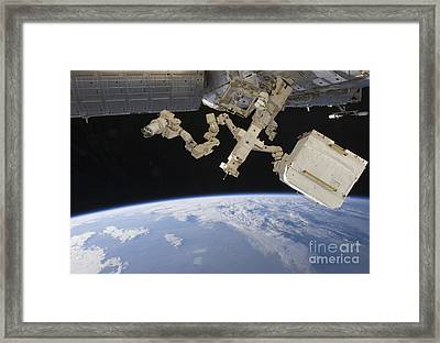 The Canadian-built Dextre Backdropped Framed Print