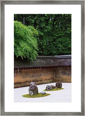The Carefully Placed Rocks And Raked Framed Print by Paul Dymond