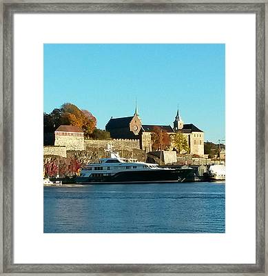 The Castle By The Waterfront Framed Print