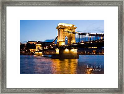 The Chain Bridge In Budapest Lit By The Street Lights Framed Print by Kiril Stanchev