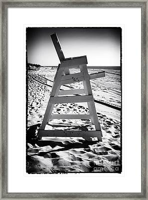 The Chair At Lbi Framed Print by John Rizzuto
