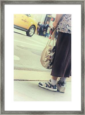 The City Moves At All Heights Framed Print by Karol Livote