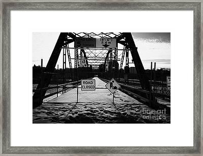 the closed old traffic bridge over the south saskatchewan river in winter downtown Saskatoon Saskatc Framed Print by Joe Fox