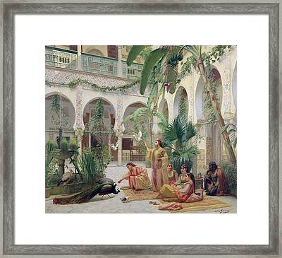 The Court Of The Harem Framed Print by Albert Girard