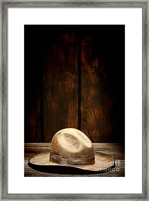 The Dirty Tan Hat Framed Print by Olivier Le Queinec