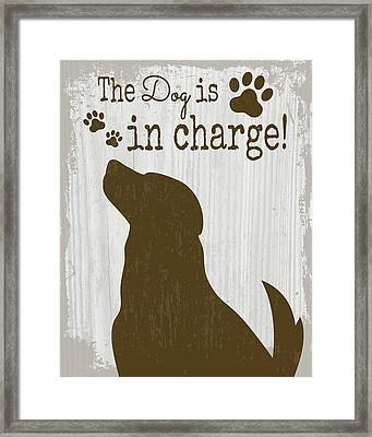 The Dog Is In Charge Framed Print