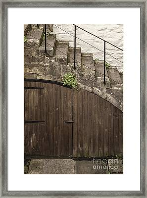 The Door Under The Stairs Framed Print by Margie Hurwich