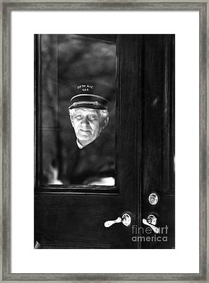 The Doorman Framed Print by Andrea Simon