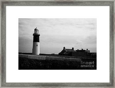 The East Light Lighthouse And Buildings Altacarry Altacorry Head Rathlin Island Against Grey Cloudy  Framed Print by Joe Fox