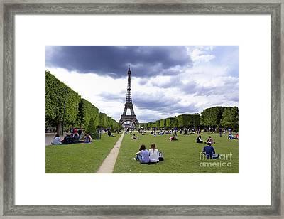 The Eiffel Tower And The Champ De Mars. Paris. France Framed Print by Bernard Jaubert