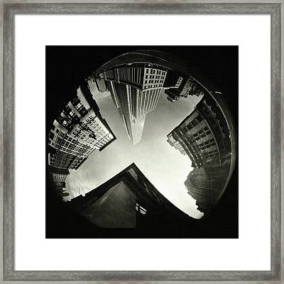 The Empire State Building In New York City Framed Print by Ralph Steiner