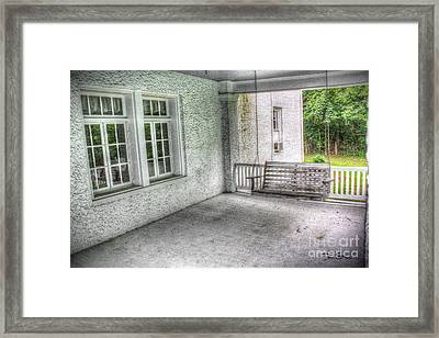 The Empty Porch Swing Framed Print