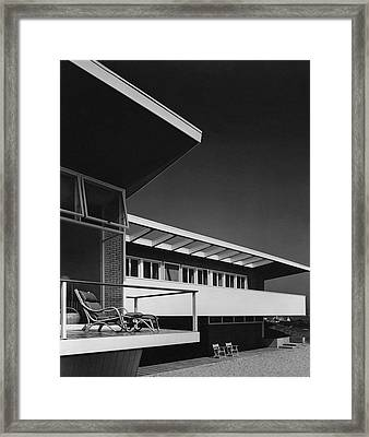 The Exterior Of A Beach House Framed Print