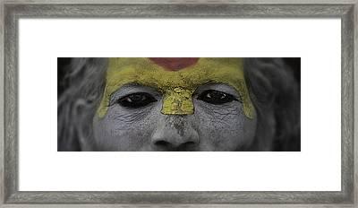 The Eyes Of A Holyman Framed Print by David Longstreath