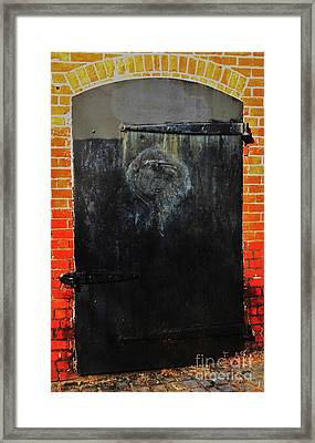 The Face In The Door 2 Framed Print
