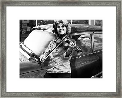The Fiddle Player Framed Print by Larry Butterworth