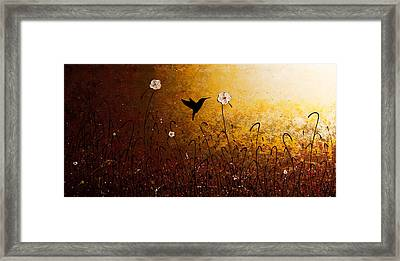 The Flight Of A Hummingbird Framed Print by Carmen Guedez