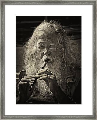 The Flutist Framed Print