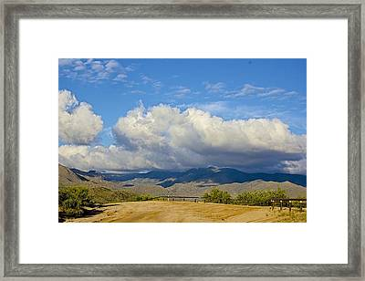 The Four Peaks Behind Clouds Framed Print by Barbara Zahno