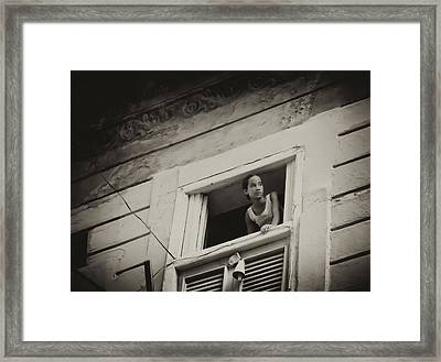 The Girl In The Window Framed Print