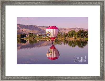 The Girl Lands  Framed Print by Jeff Swan