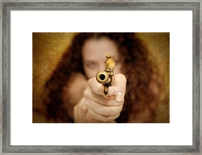The Girl With The Golden Gun Framed Print