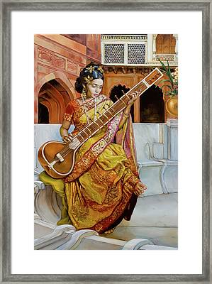 The Girl With The Sitar Framed Print by Dominique Amendola