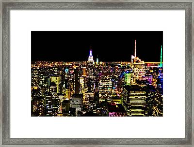 The Glow Of The New York City Skyline Framed Print by Dan Sproul