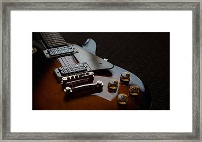 The Guitar Framed Print by Dasmin Niriella