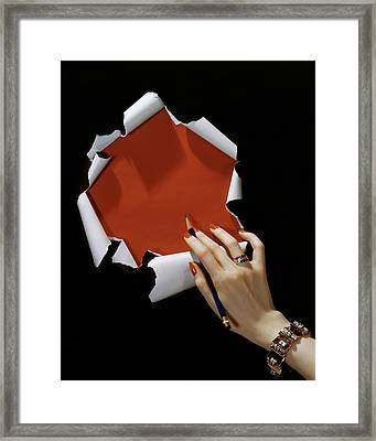 The Hand Of A Woman Reaching Towards Torn Framed Print