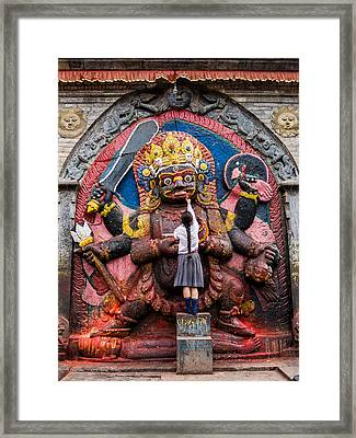 A Nepali School Girl Offers A Butter Lamp To The Fearsome Kala Bhairava Framed Print
