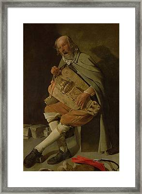 The Hurdy Gurdy Player Framed Print by Georges de la Tour