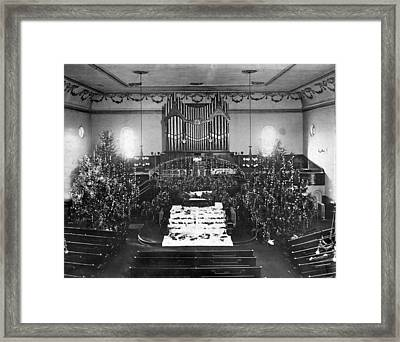 The Interior Of A Church Decorated For Christmas. Framed Print by Underwood Archives