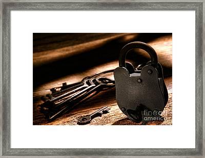 The Jailer Lock Framed Print by Olivier Le Queinec