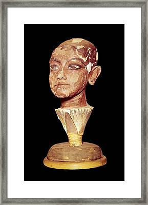 The King Tutankhamun On A Lotus Flower Framed Print by Everett