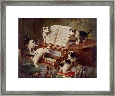 The Kittens Recital Framed Print by Carl Reichert