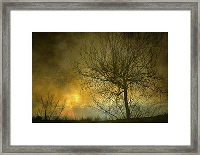 The Light Escapes Through The Clouds Framed Print by Guido Montanes Castillo