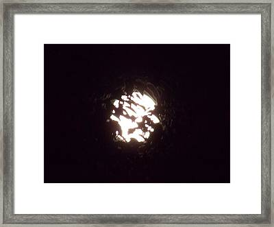The Light Shining Through A Dark World Framed Print