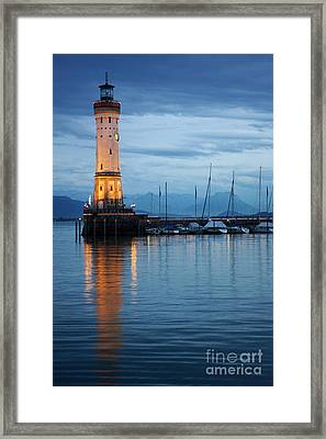 Framed Print featuring the photograph The Lighthouse Of Lindau By Night by Nick  Biemans