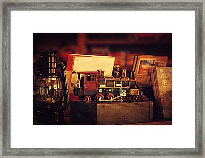 The Little Train On The Shelf Framed Print by Maria Angelica Maira
