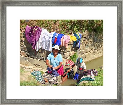 The Local Laundromat  Framed Print by Lew Davis