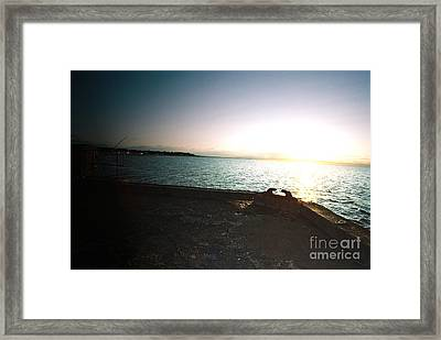 The Lonely Fisherman In The Warmth Of The Setting Sun Framed Print