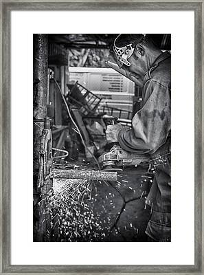 The Machinist Framed Print