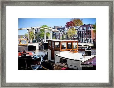 The Magere Brug Skinny Bridge In Amsterdam Framed Print by Michal Bednarek
