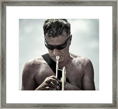 The Man His Trumpet And The Sea Framed Print by Michel Verhoef