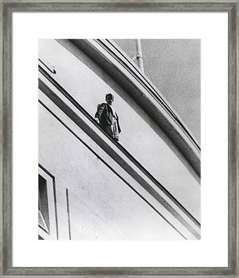 The Man In Love Is Saved From A Parapet Framed Print by Retro Images Archive