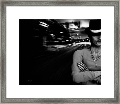 The Man In The Hat Returns Framed Print