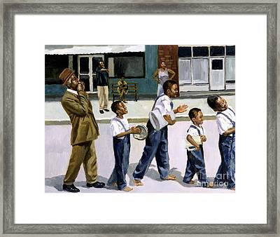 The Marching Band Framed Print by Colin Bootman
