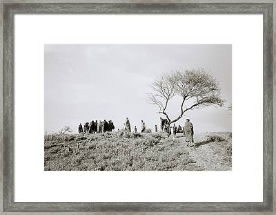 The Masai Village Framed Print by Shaun Higson