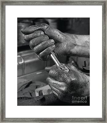 The Mechanic Framed Print by The Harrington Collection